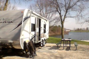 I used my camera on my laptop because we forgot our camera. Unfortunately, the laptop camera puts the picture in reverse. Sorry. Still, it gives you an idea of our first campsite in our new trailer. What fun!