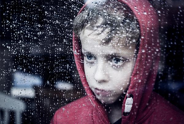 Sad-child-in-rain